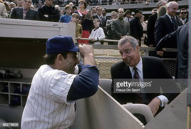 FLUSHING NY CIRCA 1980's Ex New York Yankee Outfielder Joe DiMaggio talks with ex teammate and now New York Mets Manager Yogi Berra before a circa...