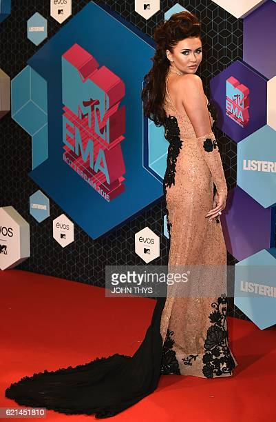 MTV's Ex on the Beach cast member Charlotte Dawson poses on the red carpet at the MTV Europe Music Awards on November 6 2016 at the Ahoy Rotterdam in...