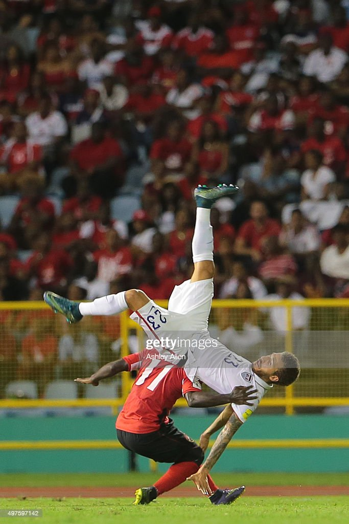 USA's #23 Fabian Johnson and T&T's #11 Trevin Caesar collide during a World Cup Qualifier between Trinidad and Tobago and USA as part of the FIFA World Cup Qualifiers for Russia 2018 at Hasely Crawford Stadium on November 17, 2015 in Port of Spain, Trinidad & Tobago.