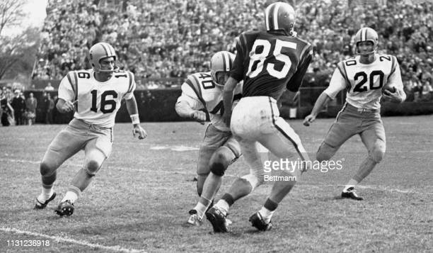 LSU's famed AllAmerican Billy Cannon gets an assist by way of a block thrown by fullback JW Brodnax on Clemson's Sam Anderson and picks up 7 yards...