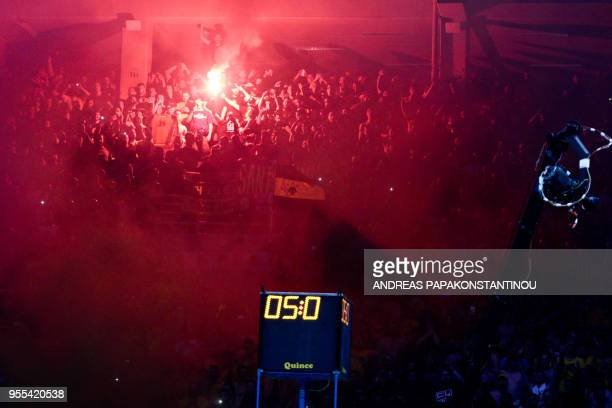 AEK's fans celebrate their team's victory with flares at the end of the Final Four Champions League basketball final game between AS Monaco and AEK...