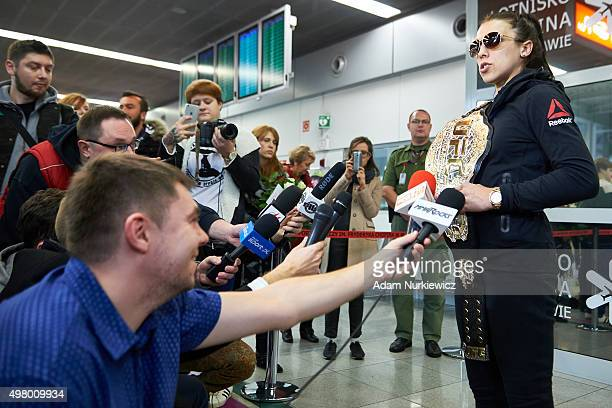 UFC's fighter Joanna Jedrzejczyk answers for questions during press briefing while her homecoming on Chopin's Airport on November 20 2015 in Warsaw...