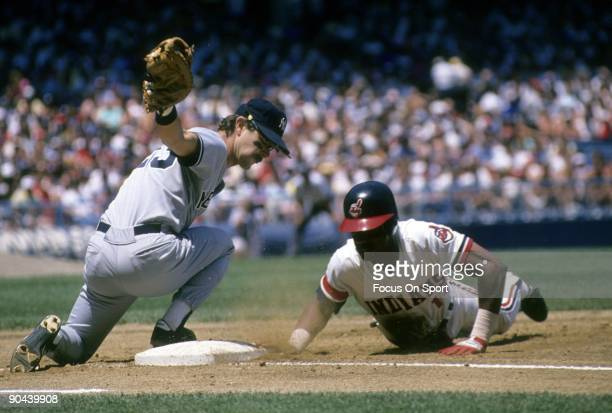 CLEVELAND OH CIRCA 1980's First baseman Don Mattingly of the New York Yankees puts a sweeping tag on Julio Franco of the Cleveland Indians diving...
