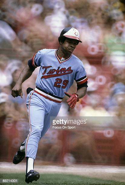 First baseman Rod Carew of the Minnesota Twins rounds first base after putting the ball in play during a MLB baseball game circa early 1970's. Carew...