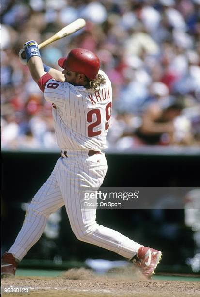 PHILADELPHIA PA CIRCA 1990's First baseman/Outfielder John Kruk of the Philadelphia Phillies swings and watches the flight of his ball during a circa...
