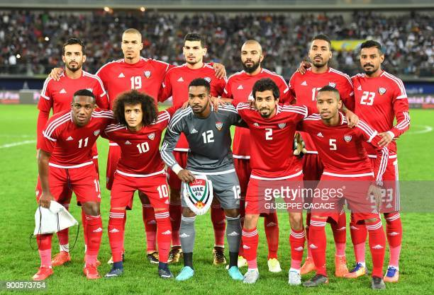 UAE's first eleven pose for a team photo at the start of the 2017 Gulf Cup of Nations semifinal football match between Iraq and the UAE at the Sheikh...