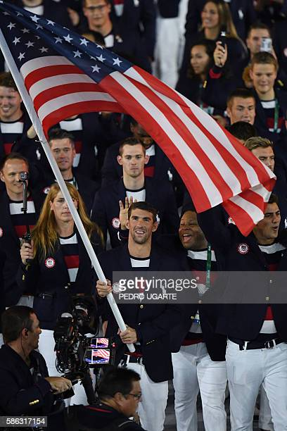 USA's flagbearer Michael Phelps leads his delegation during the opening ceremony of the Rio 2016 Olympic Games at the Maracana stadium in Rio de...