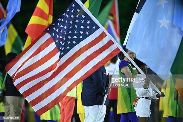 USA's flagbearer Simone Biles holds her country's national flag during the closing ceremony of the Rio 2016 Olympic Games at the Maracana stadium in...