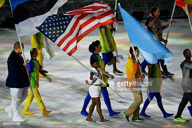 USA's flagbearer Simone Biles parades during the closing ceremony of the Rio 2016 Olympic Games at the Maracana stadium in Rio de Janeiro on August...
