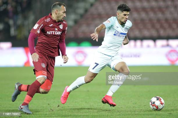 FCSB's Florinel Coman and CFR Cluj's Paulo Vinicius during the Liga I match between CFR Cluj and FCSB at DrConstantinRadulescuStadium on February 2...