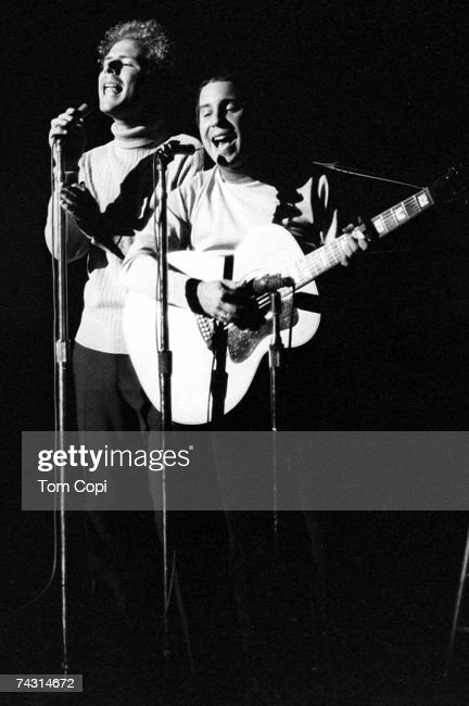 1960's folk duo 'Simon and Garfunkel' perform on stage in 1968 in San Francisco.