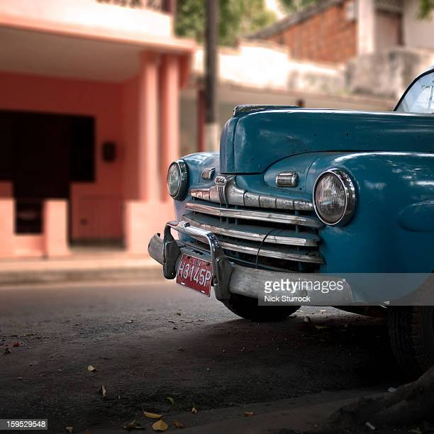 CONTENT] A 1950's Ford in pristine condition sits on a side street in the rundown town of Pinar del Rio