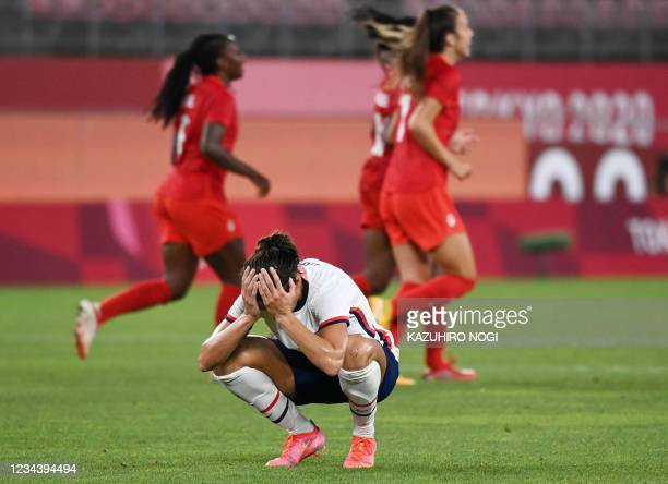 S forward Carli Lloyd reacts after a missed chance during the Tokyo 2020 Olympic Games women's semi-final football match between the United States...