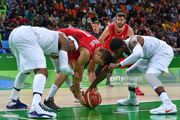 TOPSHOT USA's forward Carmelo Anthony Serbia's shooting guard Bogdan Bogdanovic and USA's guard Paul George go for the ball during a Men's round...