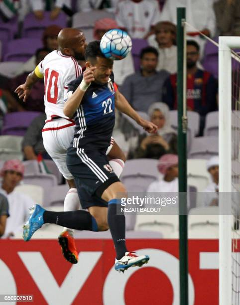 UAE's forward Ismaeil Matar vies for the header with Japan's defender Maya Yoshida during the FIFA World Cup 2018 qualifier between UAE and Japan at...