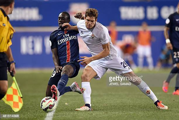 PSG's forward JeanKevin Augustin vies for the ball with Fiorentina's defender from Spain Marcos Alonso Mendoza during their International Champions...