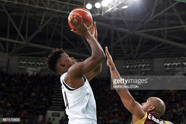 S forward Jimmy Butler goes to the basket despite Venezuela's point guard Gregory Vargas during a Men's round Group A basketball match between USA...