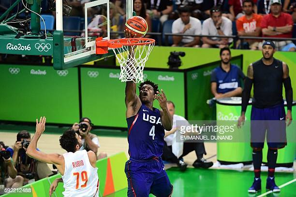 USA's forward Jimmy Butler scores as Spain's point guard Ricky Rubio looks on during a Men's semifinal basketball match between Spain and USA at the...