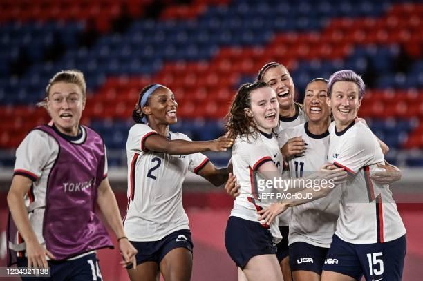 S forward Megan Rapinoe and teammates celebrate after winning the Tokyo 2020 Olympic Games women's quarter-final football match between Netherlands...