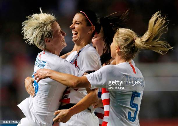 S forward Megan Rapinoe celebrates her goal with teammates Alex Morgan and McCall Zerboni during the Tournament of Nations women's football match...