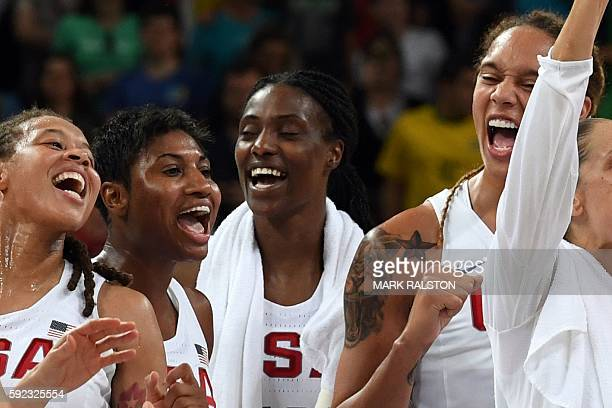 USA's forward Seimone Augustus USA's small forward Angel Mccoughtry USA's centre Sylvia Fowles and USA's centre Brittney Griner celebrate after USA...