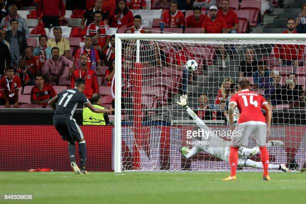CSKA's forward Vitinho shoots a penalty to score against Benfica's Portuguese goalkeeper Bruno Varela during UEFA Champions League football match SL...
