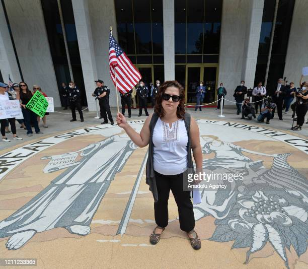 S founder Ashley Smith is seen as protesters gather for pressure North Carolina Governor Roy Cooper to reopen the State in Raleigh, NC, United States...