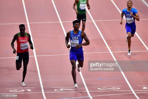 S Fred Kerley crosses the finish line ahead of Kenya's Emmanuel Kipkurui Korir in the Men's 400m semi-final at the 2019 IAAF Athletics World...