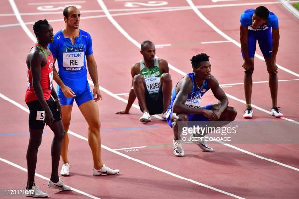 S Fred Kerley , Italy's Davide Re and Kenya's Emmanuel Kipkurui Korir wait for the results after the Men's 400m semi-final at the 2019 IAAF Athletics...