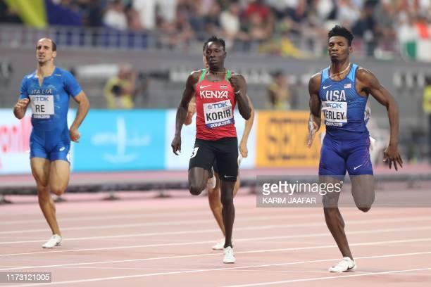 S Fred Kerley runs past Italy's Davide Re and Kenya's Emmanuel Kipkurui Korir on his way to winning the Men's 400m semi-final at the 2019 IAAF...