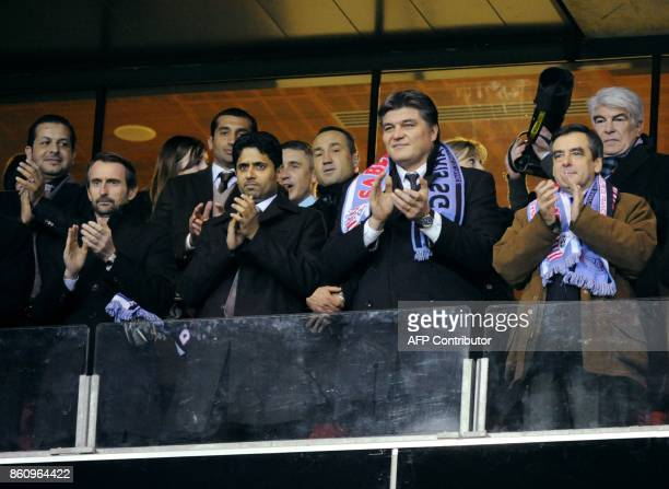 PSG's French managing director JeanClaude Blanc flanked by Paris SaintGermains Qatar President and CEO Nasser Al Khelaifi Prime Minister Francois...