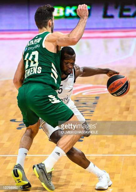 S French player Charles Kahudi fights for the ball with Panathinaikos' Greek player Ioannis Papapetrou during of the Euroleague basket-ball match...