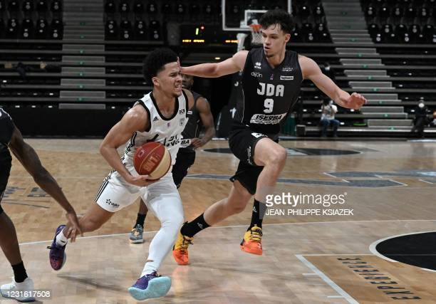 S French point guard Matthew Strazel fights for the ball with Dijon's Belgian power forward Hans Vanwijn during the French Elite basketball match...