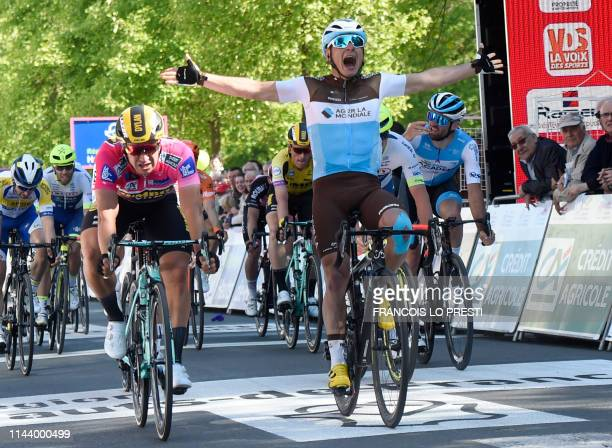 S French rider Clement Venturini rises his arms in victory as he crosses the finish line, prior to being relegated, leading to Team Jumbo-Visma Dutch...