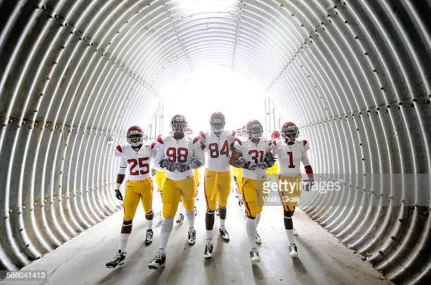 OCOTBER 18TH 2008––USC's from left Daniel Harper DaJohn Harris Kyle Moore Stanley Havili and Patrick Turner march out to the field before a game with...