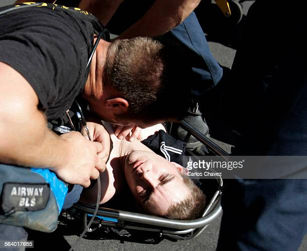 EMT's from the Fresno Fire Dept aid Ryan Nale who blacked out on the roof of his buisness as he worked to repaire an air conditionor in Fresno...