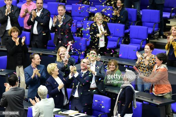 TOPSHOT MP´s from the Green party celebrate with confetti following a debate and vote on samesex marriage in Bundestag Germany´s lower house of...
