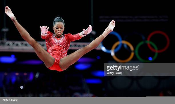 USA's Gabrielle Douglas competes on the uneven bars in the Women's Team Final at the 2012 London Olympics Tuesday
