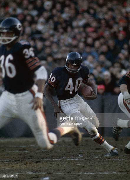 CHICAGO IL CIRCA 1960's Gale Sayers of the Chicago Bears carries the ball in a mid circa 1960's NFL football game at Wrigley Field in Chicago...