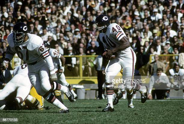 BAY WI CIRCA 1960's Gale Sayers of the Chicago Bears carrying the ball against the Green Bay Packers in a late circa 1960's NFL football game at...