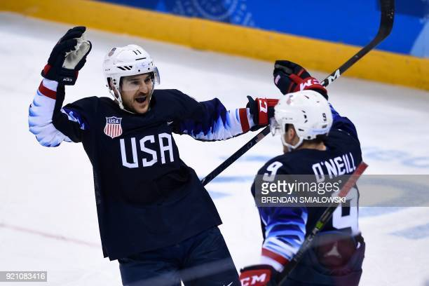 USA's Garrett Roe celebrates his goal with USA's Brian O'Neill during the final period of the men's quarterfinals playoffs ice hockey match between...