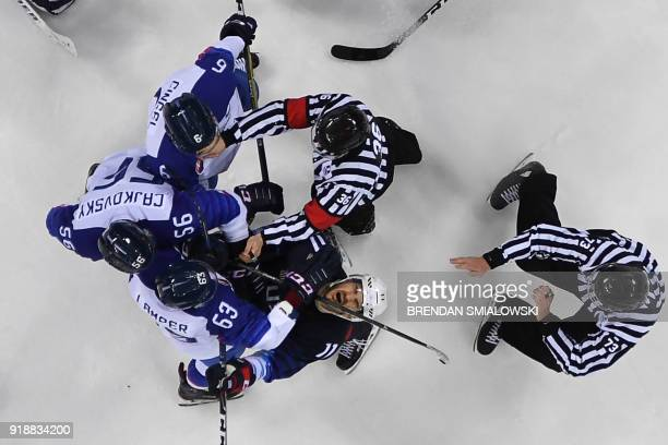 S Garrett Roe reacts during a clash with Slovakia's players in the men's preliminary round ice hockey match between the US and Slovakia during the...