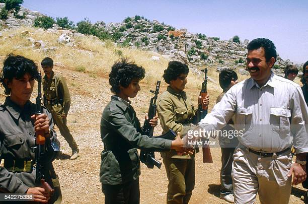 PKK's General Secretary and military leader Abdullah Ocalan greets women soldiers at the Mahsun Korkmaz Academy military training camp | Location...
