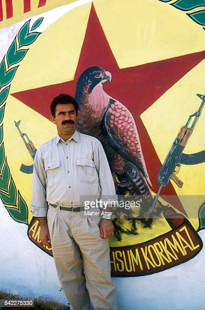 PKK's General Secretary and military leader Abdullah Ocalan stands in front of the symbol for the Mahsun Korkmaz Academy military training camp |...