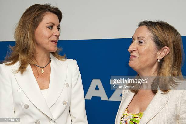 's General Secretary Maria Dolores de Cospedal and Spain's Minister of Development Ana Pastor attend the 'La Razon' newspaper meeting on July 22 2013...
