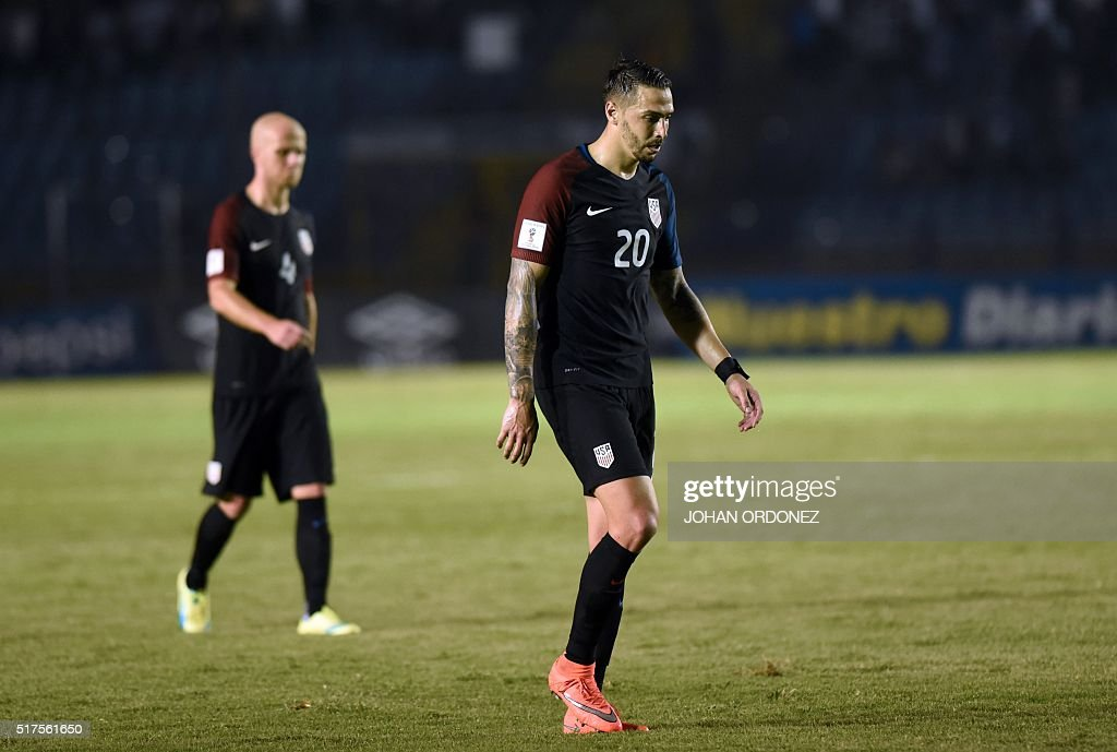 USA's Geoff Cameron leaves the field in dejection after being defeated by Guatemala 2-0 in a Russia 2018 FIFA World Cup Concacaf Qualifiers' football match, in Guatemala City, on March 25, 2016.