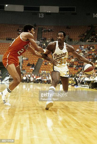 INDIANAPOLIS IN CIRCA 1970's George McGinnis of the Indiana Pacers drive the basket ball during a early circa 1970 ABA basketball game in...