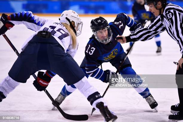 S Gigi Marvin and Finland's Riikka Valila wait to face off during the final period of the women's preliminary round ice hockey match between Finland...
