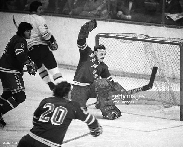 BOSTON MA 1970's Gilles Villemure goalie of the New York Rangers tends goal against the Boston Bruins at Boston Garden