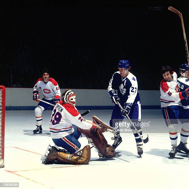 MONTREAL 1970's Goalie Ken Dryden Guy Lapointe and Serge Savard of the Montreal Canadiens defend against Darryl Sittler of the Toronto Maple Leafs